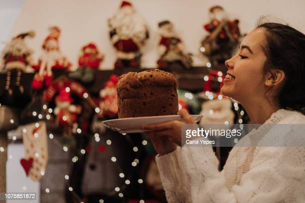woman  holding pannetone in christmas time at home - carol cook stock pictures, royalty-free photos & images