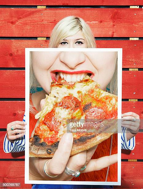 woman holding picture of pizza