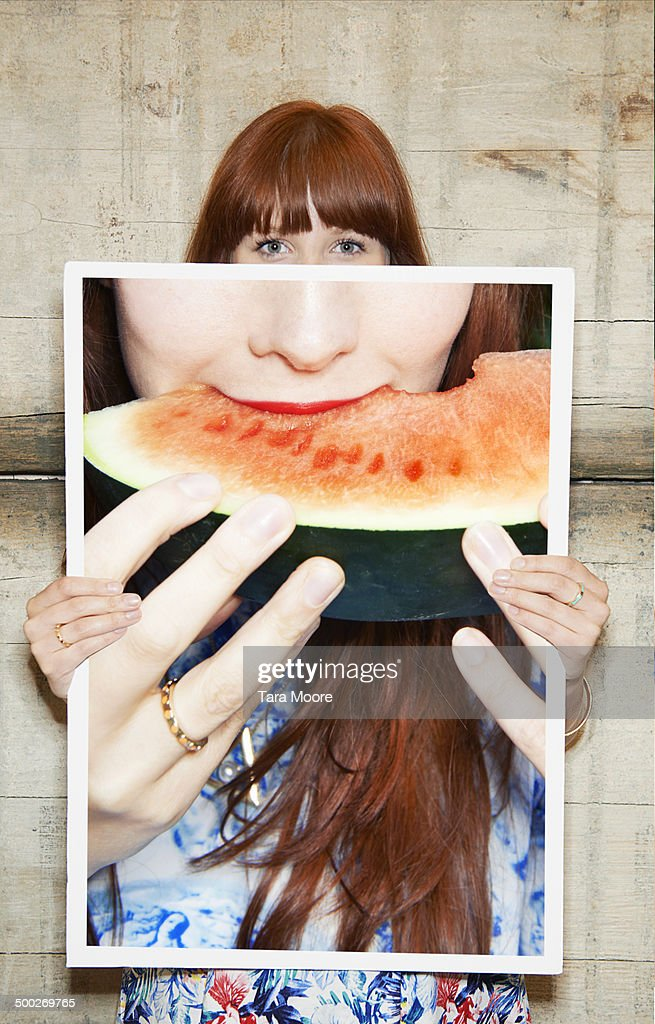woman holding picture of watermelon : Stock Photo