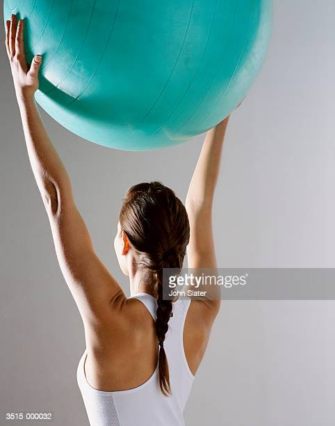 Woman Holding Pilates Ball