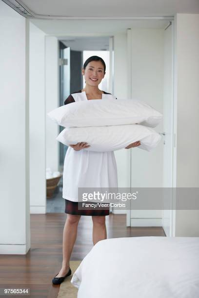 Woman holding pillows