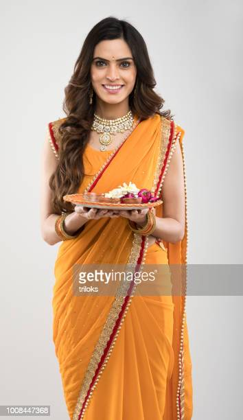 woman holding plate of religious offering - diwali celebration stock photos and pictures