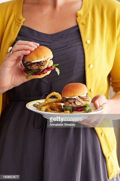 Woman holding plate of Turkey Burger Sliders