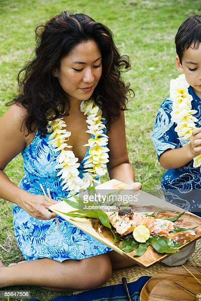 Woman holding platter of food