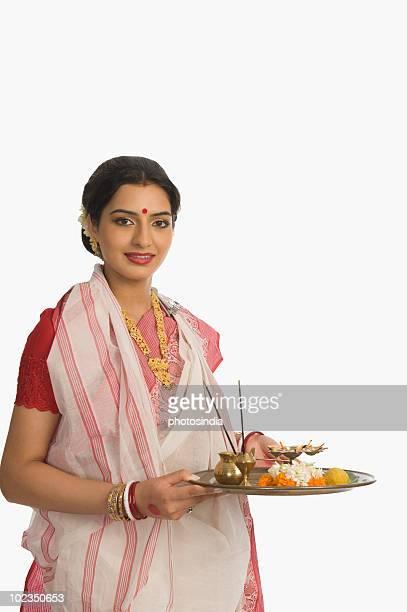 Woman holding pooja thali at Durga Puja