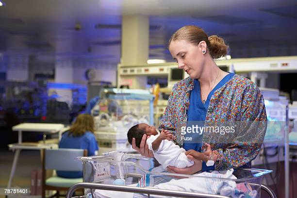 Woman Holding Premature Baby