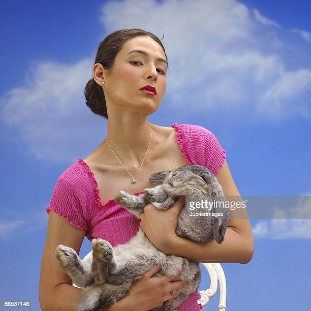 woman holding rabbit - beautiful dominant women stock pictures, royalty-free photos & images
