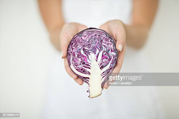 Woman Holding Red Cabbage