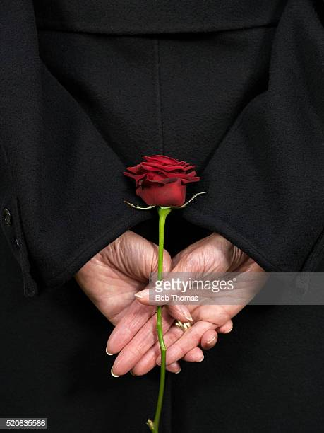 Woman Holding Red Rose Behind Back