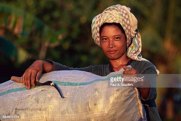 Woman Holding Rice Bag