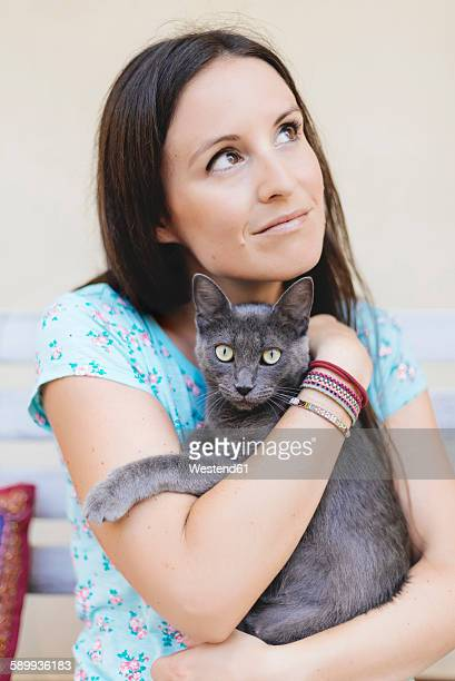 Woman holding Russian Blue