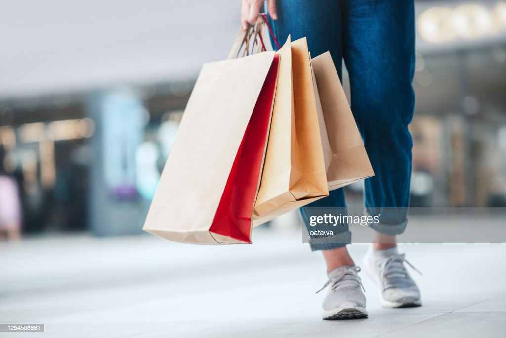 Woman holding sale shopping bags. Consumerism, shopping, lifestyle concept : Stock Photo