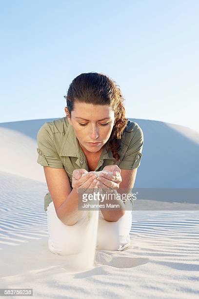 Woman Holding Sand