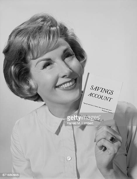 """ Woman Holding Saving Account Passbook, Smiling"""
