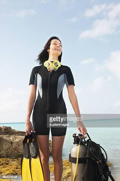 Woman holding scuba diving equipment