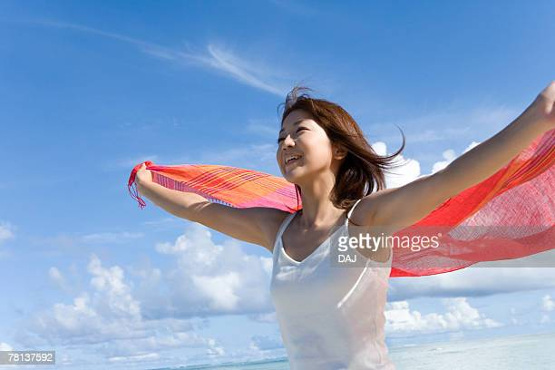 woman holding shawl behind back on beach, smiling, saipan  - shawl stock pictures, royalty-free photos & images