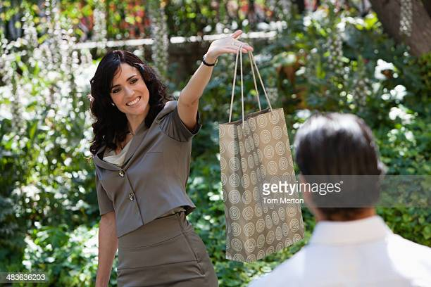 woman holding shopping bag - striding stock pictures, royalty-free photos & images