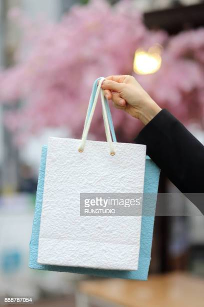 Woman holding shopping bags, close-up