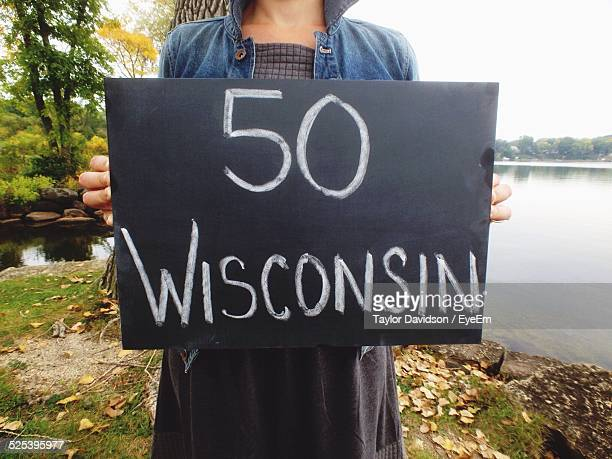 woman holding sign 50 wisconsin - iron_county,_wisconsin stock pictures, royalty-free photos & images