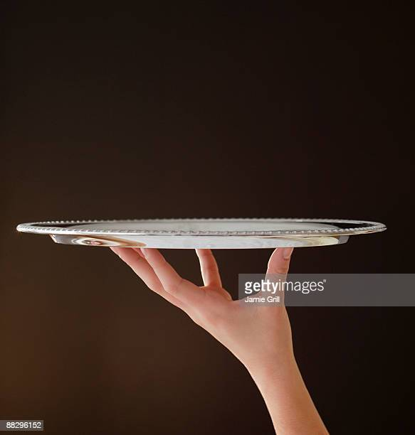 Woman holding silver tray