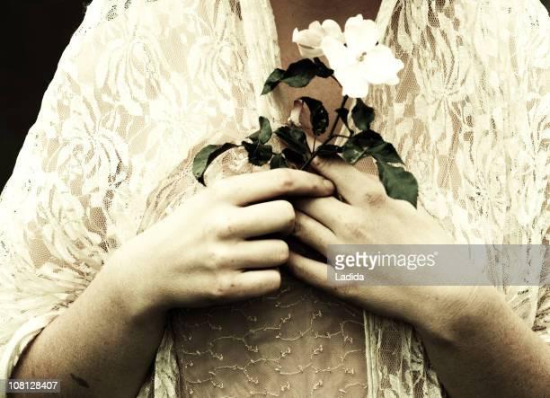 Woman Holding Single Flower