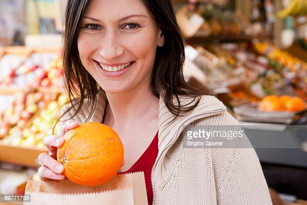 Woman holding small pumpkin