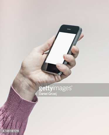 Woman Holding Smartphone Stock Photo - Getty Images