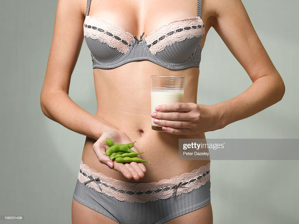 Woman holding soya beans and soya milk : Stock Photo