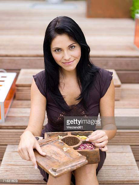 Woman holding spice box, smiling