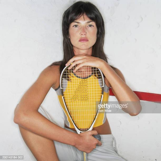 woman holding squash racquet, portrait - squash sport stock pictures, royalty-free photos & images