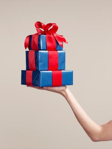 Woman holding stack of gifts - gettyimageskorea