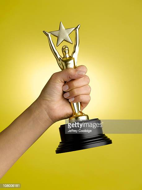 Woman Holding Star Trophy