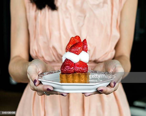 Woman Holding Strawberry Cake
