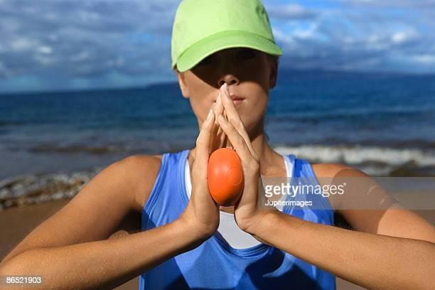 Woman holding stress ball