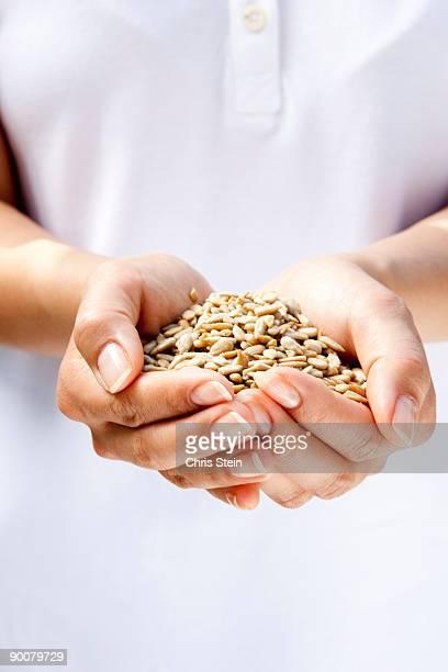 Woman holding sunflower seeds