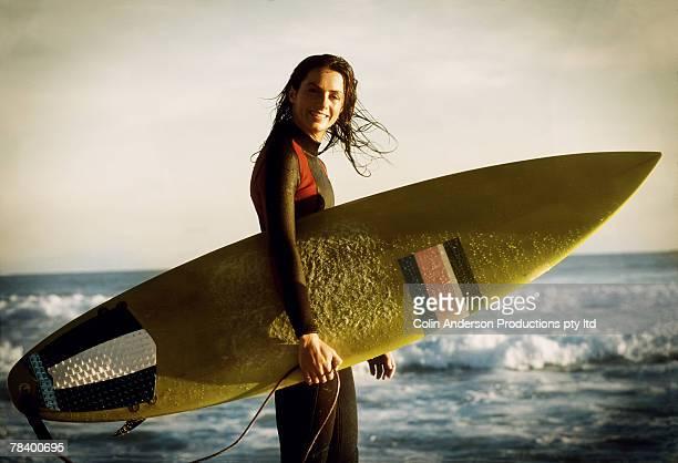 Woman holding surfboard