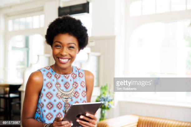 Woman holding tablet and smiling
