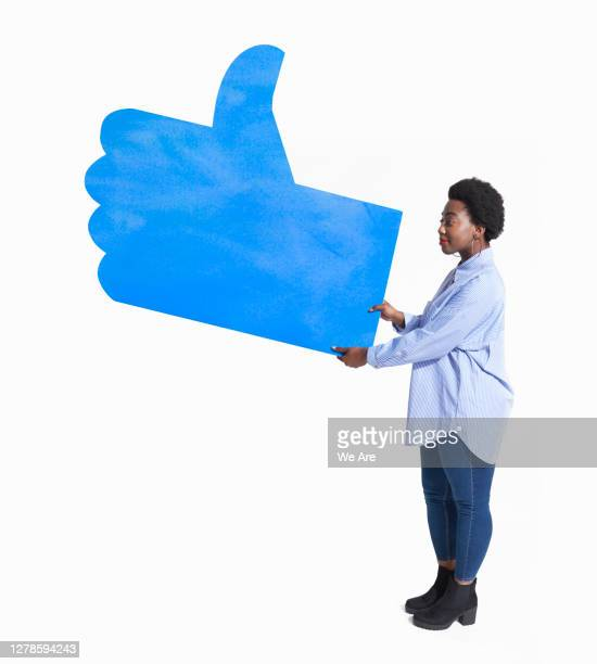 woman holding thumbs up sign - like button stock pictures, royalty-free photos & images