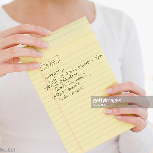 Woman holding To Do list