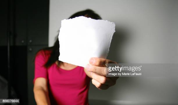 Woman holding torn paper