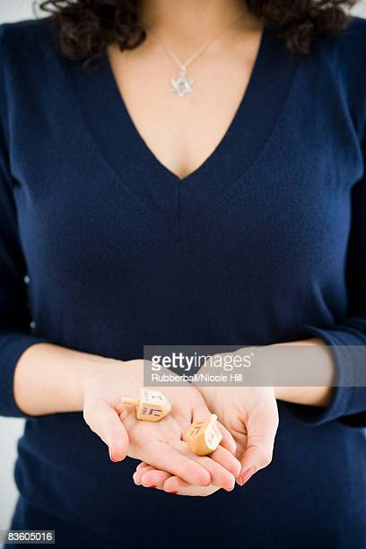 woman holding tow dradles - hannukkah stock pictures, royalty-free photos & images