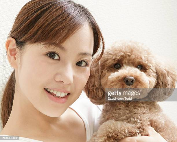 Woman Holding Toy Poodle