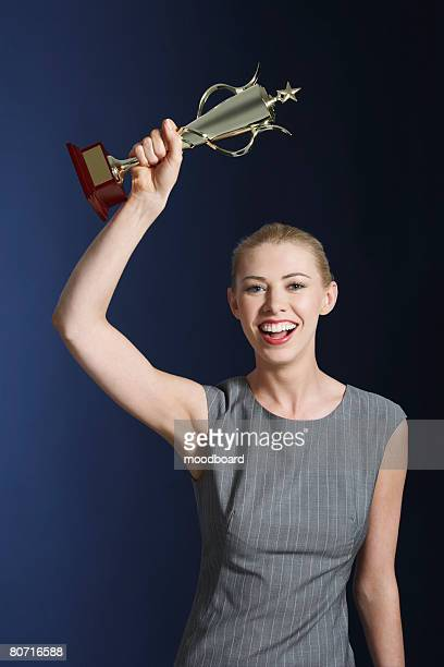 Woman Holding Trophy
