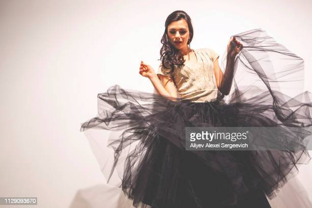 woman holding tulle skirt dancing - tulle netting stock pictures, royalty-free photos & images