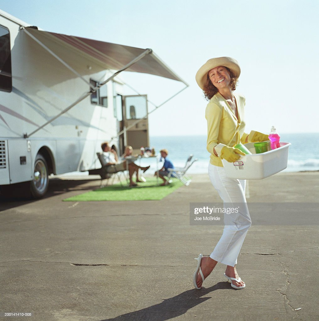 Woman Holding Tupperware With Dishes And Soap Rv Camping