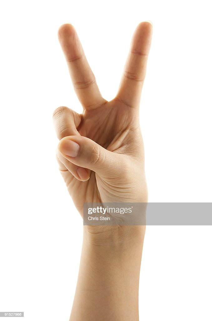 Woman holding two fingers up : Stock Photo