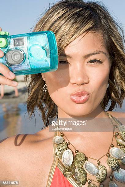 Woman holding underwater camera