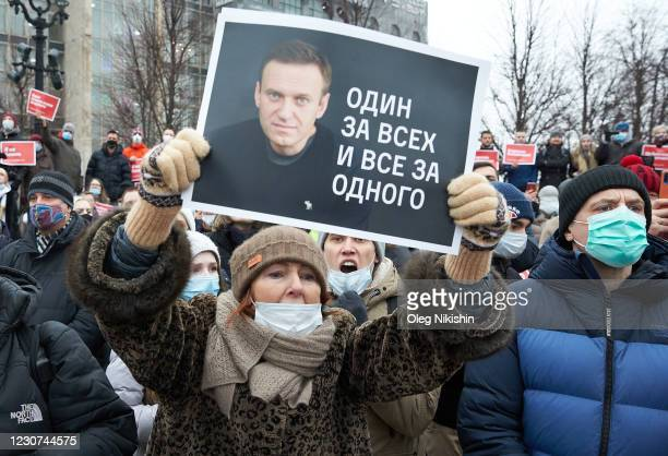 """Woman holding up a placard reading """"Navalny is not afraid and I'm not afraid"""" attends a rally in support of jailed opposition leader Alexei Navalny..."""