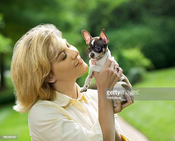 Woman holding up chihuahua