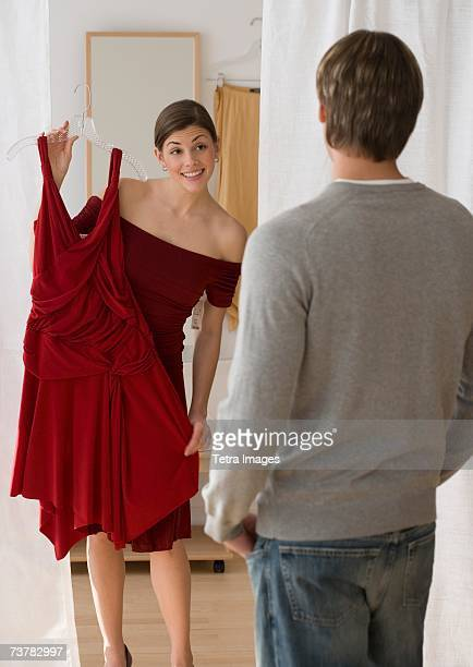 Woman holding up dress for boyfriend